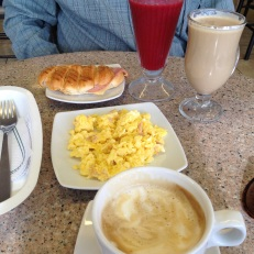 American breakfast: coffee, juice, eggs and a sandwich for $3.50