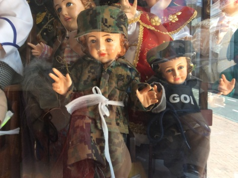 They have dress-up Baby Jesus dolls.  Here's one in camo.